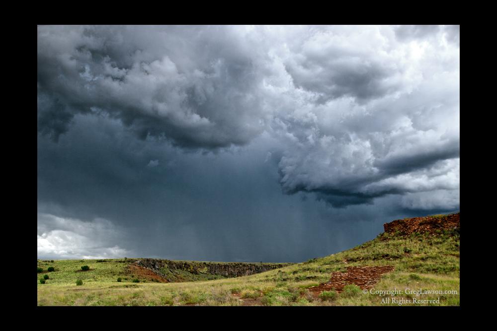Ruins under dramatic sky on the Colorado River Plateau, Greg Lawson Galleries in Sedona, Arizona