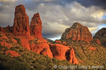 The Sisters and City Hall rock formations in Sedona, Arizona. Featured in the book: Sedona - The Nature of the Place and at the Greg Lawson photography art gallery in Sedona, Arizona, USA.