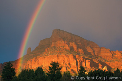 Rainbow over Elephant Rock and Chapel of the Holy Cross, Sedona, Arizona, USA. From the book: Sedona - The Nature of the Place and the Greg Lawson photography art gallery in Sedona, Arizona.